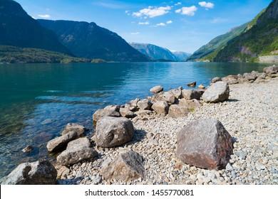 beautiful rocky shore of a norwegian fjord lake