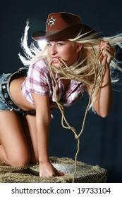 Beautiful rodeo girl in sheriff hat