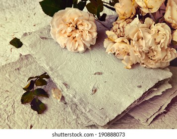 beautiful romantic background with white roses, petals and handmade paper, Soft spring flower background/ love background
