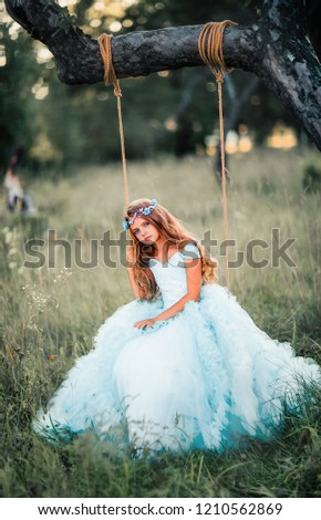 2c676e785197 Beautiful romantic blonde girl with blue eyes posing in forest. Dreaming  princess in fairy blue