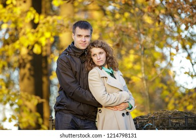 Beautiful romantic couple embracing outdoors. Early fall.