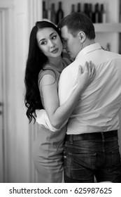Beautiful romantic couple hugging in restaurant