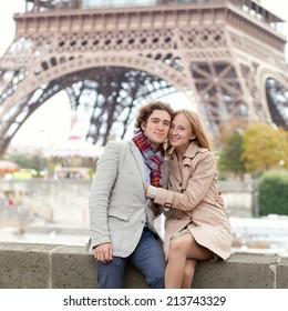 Beautiful romantic couple in Paris near the Eiffel Tower