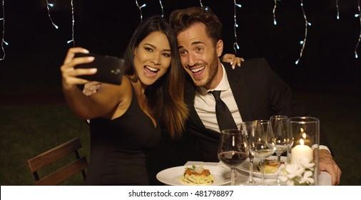 Beautiful romantic couple posing for a selfie
