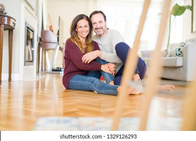 Beautiful romantic couple sitting together on the floor at home