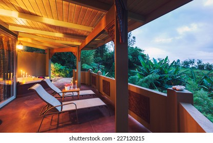 Beautiful Romantic Deck on Tropical Home at Sunset with Candles