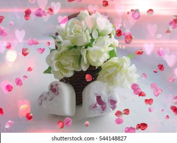 Beautiful romantic flowers , on the soft background with little hearts and rose petals