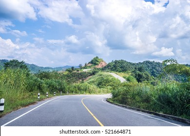 Beautiful romantic mountain route in Thailand, Rural road No.1081, Curve of road,tropical road in jungle, Scenic view. Road Landscape in Nan, Northern part Thailand