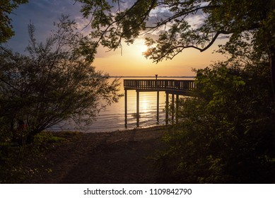 beautiful romantic scenery at lake shore chiemsee with viewpoint at sunset