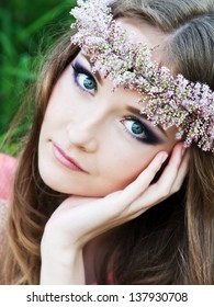 Beautiful romantic woman with flower wreath