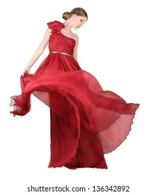 Beautiful, romantic woman in long red dress, luxurious red gown flowing...