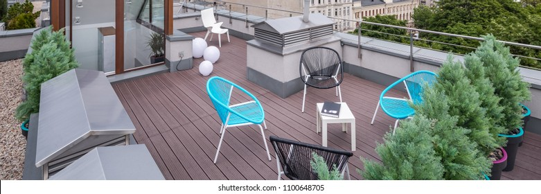 Beautiful roof patio with new design chairs and small table, panorama