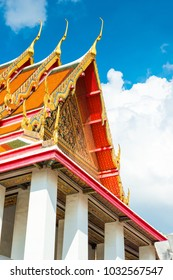 beautiful roof of temple of Thailand with sharp peaks against the blue sky