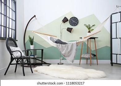 Beautiful room interior with comfortable hammock