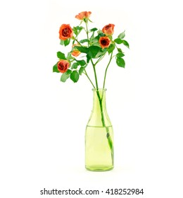 Beautiful rose isolated on white. Orange rose. Perfect for background greeting cards and invitations of the wedding, birthday, Valentine's Day, Mother's Day. Glass colorful vase bottle with water