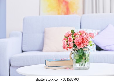 Beautiful rose in vase on table in room