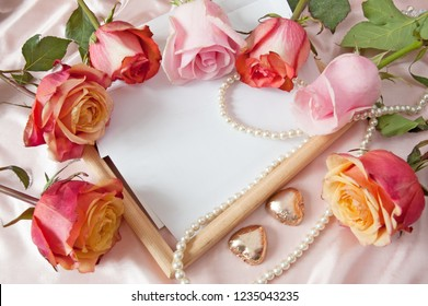 beautiful roses bunch, frame, pearls necklace and chocolate candies like hearts, wedding card, valentine card, love card
