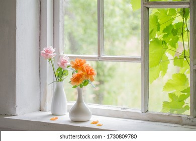 beautiful roses in vases on old wooden windowsill - Shutterstock ID 1730809780