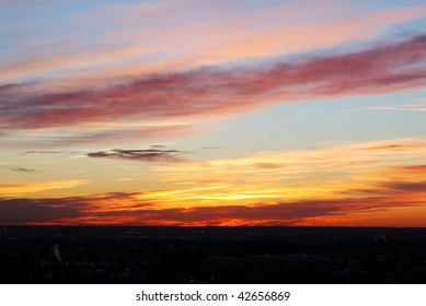 Beautiful rosy clouds and sky at sunrise moment, city edmonton, alberta, canada