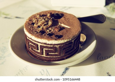 Beautiful round chocolate cake with decorations in a cafe, food party menu background