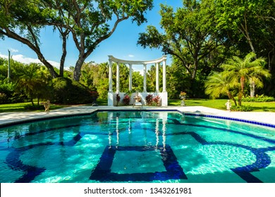 Beautiful round greco roman style swimming pool in a luxury estate home.