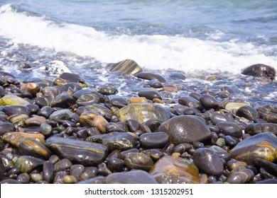 Beautiful round-rock pattern on beach with sea water at Lipe island, Satun province, Thailand