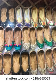A beautiful rows of Indian punjabi khussa or juttis what it's been called in India. A shoe made of leather with extensive thread work and embroidery designed for both men and women.