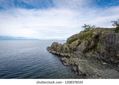 Beautiful rugged and rocky shoreline at Pipers Lagoon Park looking out to the ocean water of the Strait Of Georgia in  the city of Nanaimo on Vancouver Island on the West coast of Canada