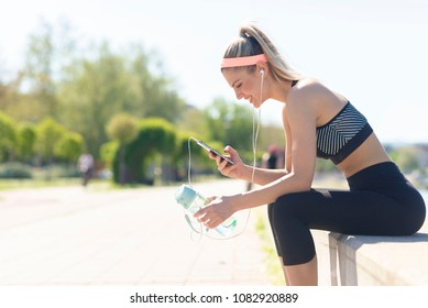 Beautiful runner taking a break from workout