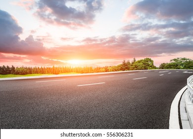Beautiful rural asphalt road scenery at sunset
