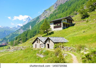 Beautiful rural houses in Swiss Alps close to Zermatt, Switzerland. Famous Matterhorn in background with snow on top. Summer Alpine landscape. Countryside. Beautiful nature. Travel destination.