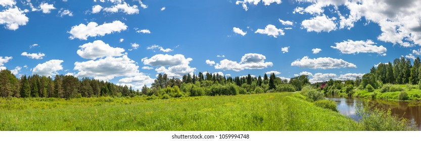 beautiful rural summer landscape with forest, river, blue sky and white clouds, a panorama. spring landscape with meadow panoramic view.