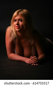 Beautiful russian blonde girl with big breasts in the underwear