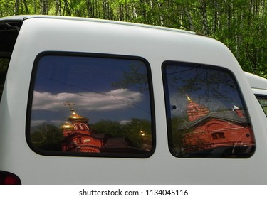 Beautiful Russian Church somewhere in the heartland of Russia. The reflection of the domes.