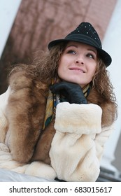Beautiful Russian in a fur coat and a hat