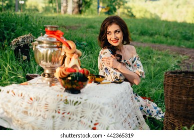 Beautiful Russian girl in the decoration on the nature