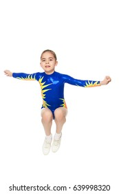 Beautiful Russian girl gymnast younger school age, in blue in a sports swimsuit.She performs a complex leap.Isolated on white background.