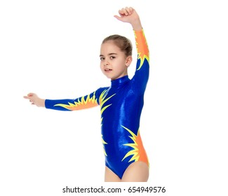 Beautiful Russian girl gymnast younger school age, in blue in a sports swimsuit.The girl performs a difficult acrobatic exercise.Isolated on white background.