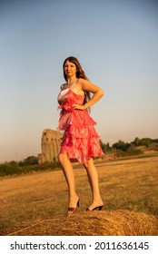 Beautiful Russian girl at the park, wearing a dress