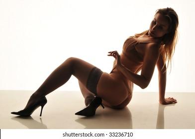 Beautiful Russian woman in beige lingerie