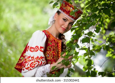 Beautiful Russian woman in national clothes