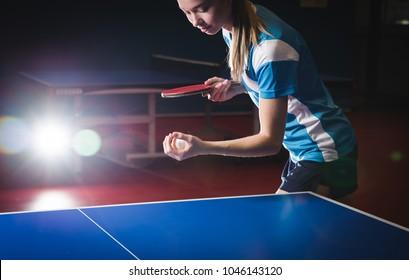 beautiful russian woman playing table tennis