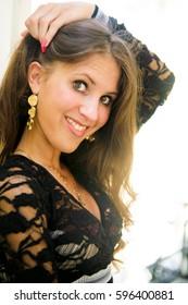 beautiful Russian woman in a slinky black dress