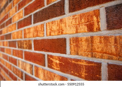 Beautiful rustic brickwork in perspective, brick wall detail with shallow depth of field