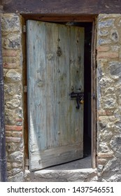 A beautiful rustic wooden door in a town