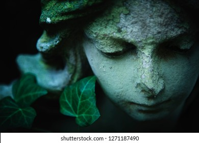 Beautiful sad angel. Portrait of ancient statue. Fragment of sculpture. Religion, faith, death, resurrection, eternity concept.