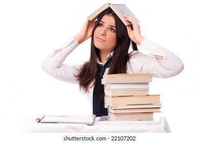 beautiful sad student unwilling to do homework isolated against white background