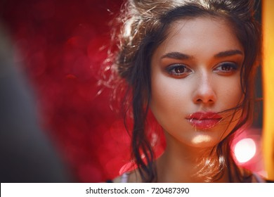 Beautiful Sad Woman Face Looking Away on Colorful Background. Pensive Girl Looking Down