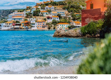 Beautiful sailing yacht near picturesque seacoast. Assos village Mediterranean Sea, Greece. Summer vacation on Greek Island