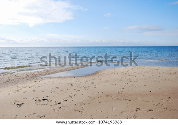 Beautiful sand beach and blue water at Byrum on the Swedish island Oland